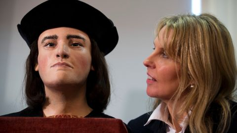 Philippa Langley stands besides a facial reconstruction of King Richard III on February 5, 2013 in London.