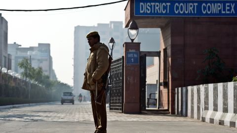 Indian police stand guard outside the Saket district court in New Delhi on January 21.