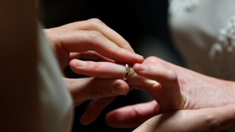 Sharon Papo places a ring on the finger of her partner Amber Weiss as they are married at San Francisco City Hall June 17, 2008 in San Francisco, California. Same-sex couples throughout California are rushing to get married as counties begin issuing marriage license after a State Supreme Court ruling to allow same-sex marriage. (Photo by Justin Sullivan/Getty Images)