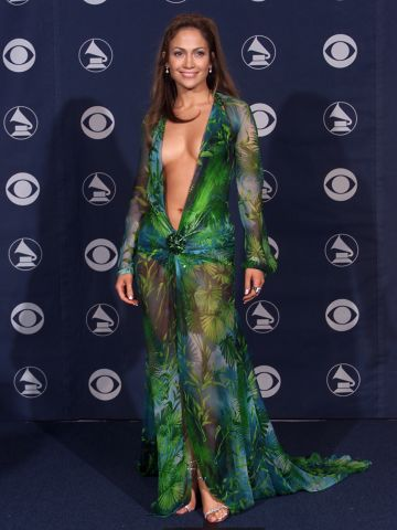 """The green Versace dress that Jennifer Lopez wore to the 2000 Grammy Awards might be her most iconic look to date. """"Those fashion moments happen by mistake -- you can't plan things like that,"""" Lopez has said of the risque ensemble. But daring looks like this may be a thing of the past if <a href=""""http://marquee.blogs.cnn.com/2013/02/07/cbs-wants-grammys-talent-covered-up/"""" target=""""_blank"""">CBS gets its way</a> this Sunday (February 10). Let's look back at the Grammys' most scandalous styles."""