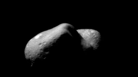 If you really want to know about asteroids, you need to see one up close. NASA did just that. A spacecraft called NEAR-Shoemaker, named in honor of planetary scientist Gene Shoemaker, was the first probe to touch down on an asteroid, landing on the asteroid Eros on February 12, 2001. This image was taken on February 14, 2000, just after the probe began orbiting Eros.