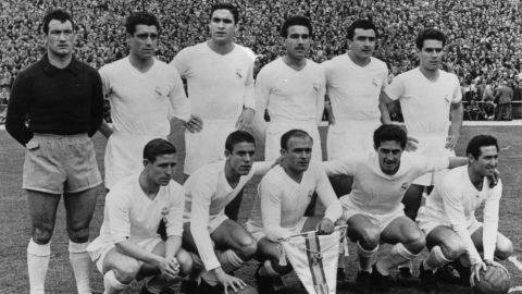 The Real Madrid team poses for a photograph ahead of the second leg of the European Cup semifinal against Manchester United at Old Trafford in 1957 with captain Alfredo Di Stefano clutching his side's pennant.