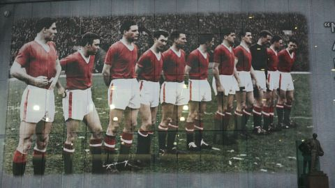 This giant mural outside Old Trafford next to the statue of Busby depicts the United team lining up at their European Cup game with Red Star Belgrade before the disaster at Munich airport on February 6, 1958. Their legacy will never be forgotten.