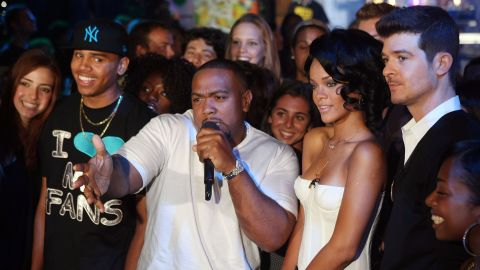 """In August 2007, Brown and Rihanna joined Timbaland, center, and Robin Thicke onstage during MTV's """"Total Request Live"""" in New York"""