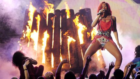 """Rihanna performs onstage during the 2011 Grammy Awards. In February, Schnegg <a href=""""http://www.cnn.com/2011/SHOWBIZ/celebrity.news.gossip/02/22/chris.brown.hearing/index.html"""">lifted the """"stay away"""" order</a> imposed on Brown."""
