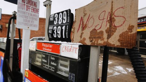 A sign bears bad news on a fuel pump in Manhasset, New York, on February 8.