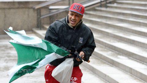 Ricky Varona copes with the wind and precipitation February 8 in New York.