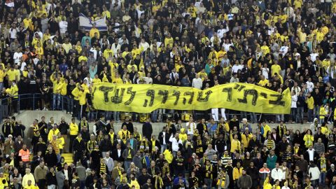 """Beitar Jerusalem fans display a banner reading """"Beitar -- pure forever"""" at a match on January 26 after their signing of two Muslim players."""