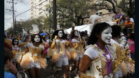 The New Orleans Baby Doll Ladies march in the Zulu parade during Mardi Gras 2012.