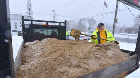 Jerry Trebino loads sand onto the back of a snowplow February 8 in Wrentham, Massachusetts. The storm is expected to spawn travel headaches for a large swath of the region.