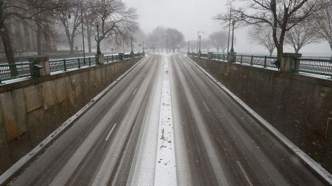 Memorial Drive sits empty following a driving ban and state of emergency that was issued in Boston on Friday.