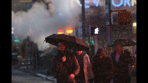Pedestrians battle wind, snow and sleet in Manhattan on Friday.