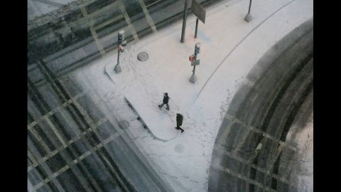 People walk through the snow in Boston's Back Bay neighborhood on Friday.