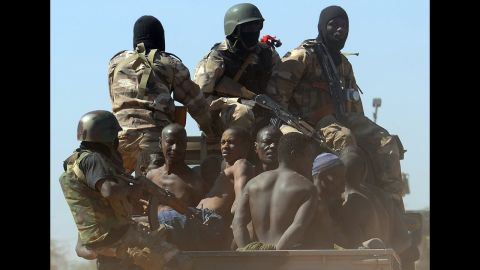 Malian soldiers transport in a pickup truck a dozen suspected Islamist rebels on Friday, February 8, after arresting them north of Gao.  A suicide bomber blew himself up on February 8 near a group of Malian soldiers in the northern city, where Islamist rebels driven from the town have resorted to guerilla attacks.