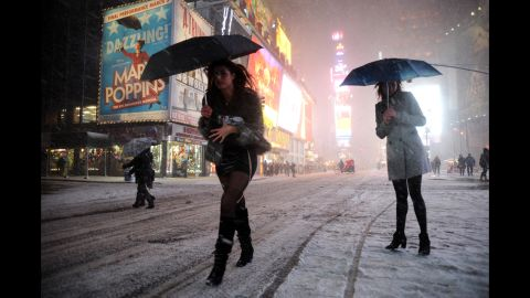 Two women look for a taxi in snow-covered Times Square on February 8.