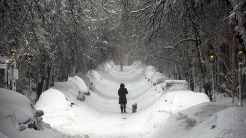 A woman walks in Boston on Saturday.
