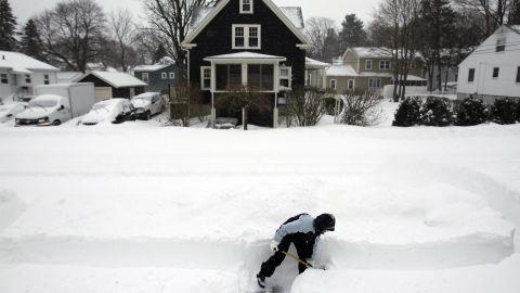 Mary Leahy shovels her sidewalk in Medford, Massachusetts.