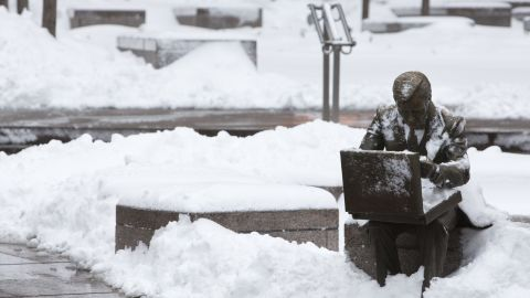 """The sculpture """"Double Check"""" by John Seward Johnson II is seen in Zuccotti Park following a major winter storm on Saturday in New York City on Saturday."""