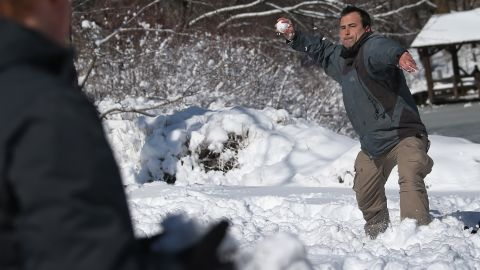 People play in the snow in New York's Central Park on Saturday.