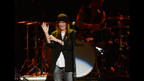 """Singer Patti Smith waves to the audience during her performance of """"Because the Night."""""""