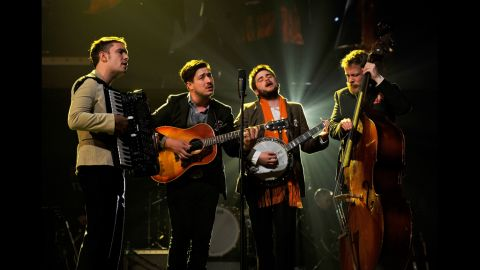 """Left to right: Musicians Ben Lovett, Marcus Mumford, """"Country"""" Winston Marshall and Ted Dwane of Mumford & Sons perform """"I'm on Fire."""""""