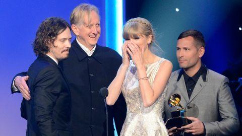 Taylor Swift accepts the Grammy award for best song written for visual media along with John Paul White and T Bone Burnett.