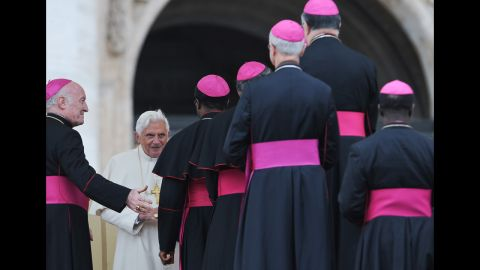 Pope Benedict XVI (2nd L) talks with bishops on Saint-Peter's square at the Vatican after his weekly general audience on November 4, 2009.  AFP PHOTO / ANDREAS  SOLARO (Photo credit should read ANDREAS SOLARO/AFP/Getty Images)