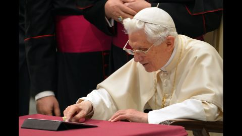 Benedict clicks on a tablet to send his first tweet from his account @pontifex at the Vatican in December 2012.