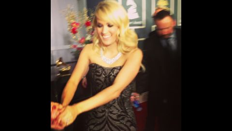 Carrie Underwood navigates the red carpet with a little help from her friends. By the end of the evening, the Grammy winner would admit she was ready to slip into something a little more comfortable.