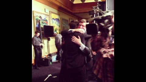 """Marcus Mumford and his proud father, John, share a heart-meltingly sweet bear hug backstage after Mumford & Sons' """"Babel"""" won album of the year."""