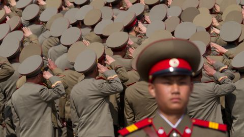 North Korean soldiers salute during a military parade in Pyongyang on April 15, 2012.