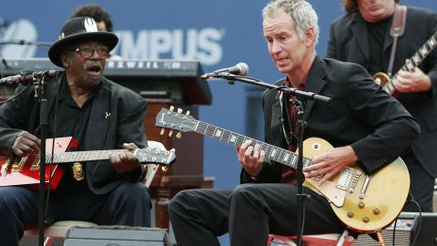 """""""American Pie."""" McEnroe is a keen musician, and is seen here performing with legendary guitarist Bo Diddley during  the U.S. Open in 2005. As well as Don McLean's 1970s classic, he's also a big fan of the Black Keys and Foo Fighters."""