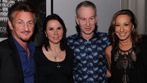 """""""Sean Penn. He played high school tennis and we seem to be cut from the same cloth.""""  The actor, far left, is pictured with McEnroe, the tennis star's wife Patty Smyth (2nd left) and Donna Karan at a Haiti relief fundraiser in 2011."""