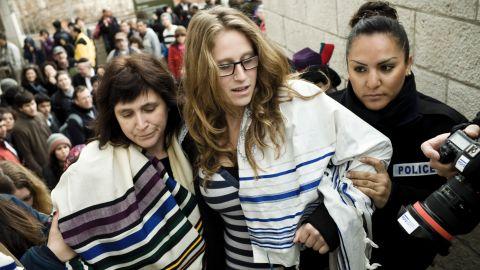 Israeli police arrest American Rabbi Susan Silverman (L) and her teenage daughter Hallel Abramowitz (C) on Monday.