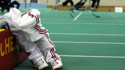 Prosthetic legs stand on the ground as Pistorius coaches children in Manchester, England, in April 2006.