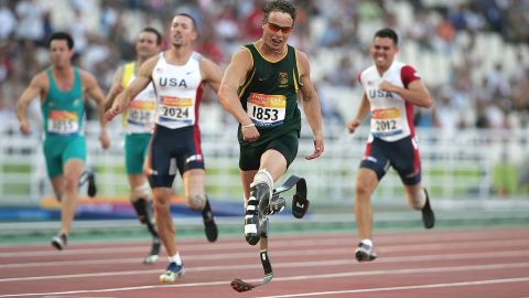 """Pistorius won gold for the first time at the 2004 Athens Paralympics. He won the 200-meter final and set a new world record. The South African sprinter was called the """"Blade Runner"""" because of his carbon-fiber prosthetic legs."""