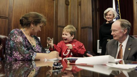 Five-year-old Ethan, who was held captive in an underground bunker for nearly a week by Jimmy Lee Dykes, and his mother Jennifer Kirkland visit with Alabama Gov. Robert Bentley in the governor's office on Wednesday, February 13.