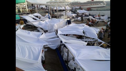 """iReporter Robin Goebel says passengers dubbed an area """"tent city"""" where many had chosen to set up temporary shelters on the deck of the disabled Carnival Triumph. Many slept on the decks of the ship because the rooms were too hot."""