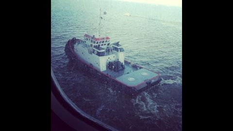 """""""One of two tugboats pulling us through the channel to Mobile, Alabama, along with a channel guide boat,"""" writes Maclaskey. The ship is being towed slowly to Mobile, Alabama, and is expected to port late February 14."""