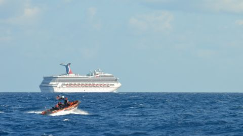 GULF OF MEXICO - FEBRUARY 11:  In this handout from the U.S. Coast Guard, the cruise ship Carnival Triumph sits idle February 11, 2013 in the Gulf of Mexico. According to the Coast Guard, the ship lost propulsion power February 10, after a fire broke out in the engine room.  (Photo by Paul McConnell/U.S. Coast Guard via Getty Images)