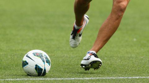 A player kicks a soccer ball on February 9, 2013 in Melbourne, Australia.