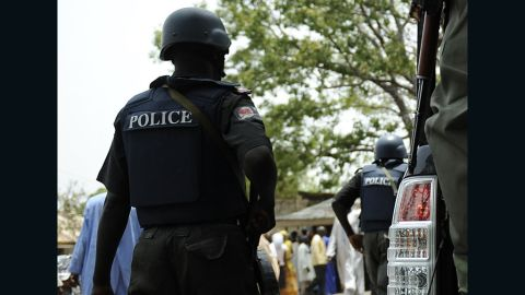 Nigeria police detain suspicious people April 28, 2011 near a polling station during a security operation to stave ballot box-snatching in Bauchi, the capital of Bauchi state, nothern Nigeria.Two Nigerian states hit hard by deadly riots after presidential elections went back to the polls for governor races Thursday amid a security lockdown and with scores still displaced. Soldiers accompanied electoral officials to polls in Kaduna and Bauchi states and the electoral commission scrambled to find some 2,000 workers to replace those who refused to show up because of fears of violence. Police and military personnel in armoured vehicles patrolled the streets of Kaduna city, the capital of the same state, and set up roadblocks to search cars. Police kept a close eye on Bauchi city, the capital of that state. AFP PHOTO / Tony KARUMBA (Photo credit should read TONY KARUMBA/AFP/Getty Images)