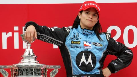 Patrick poses with the trophy after winning the Bridgestone Indy Japan 300 Mile in 2008 in Motegi, Japan.