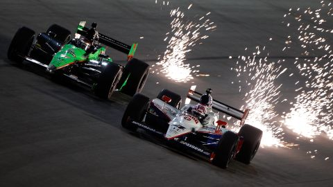 """Patrick, left, drives next to Dan Wheldon during practice for the Cafes do Brasil Indy 300 in 2010 in Homestead, Florida. <a href=""""http://www.cnn.com/2011/10/16/us/indycar-crash"""">(Wheldon died in 2011 at the Las Vegas Indy 300).</a>"""