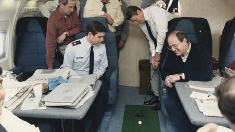 President Ronald Reagan putts a golf ball on Air Force One on November 16, 1985.