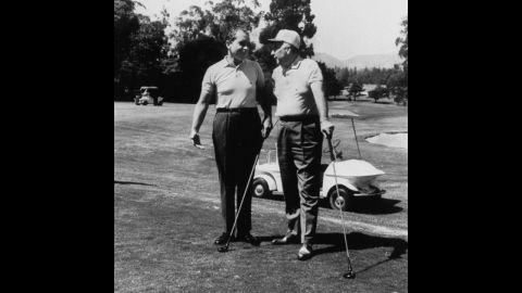President Richard Nixon and Attorney General John Mitchell play golf at the Los Angeles Country Club in 1969.