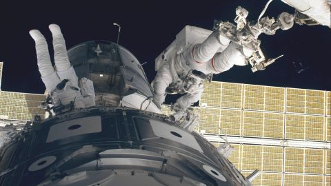 The crew of the space shuttle Endeavour initiates the station's first assembly sequence in 1998. The International Space Station includes several large modules, each launched separately and connected in space by astronauts.