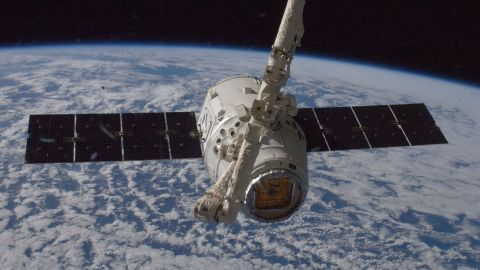 The unmanned SpaceX Dragon spacecraft connects to the space station in May 2012. It was the first private spacecraft to successfully reach an orbiting space station.