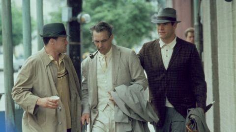 """Kevin Costner, center, plays District Attorney Jim Garrison, who investigates the assassination of President John F. Kennedy, in the 1991 Oliver Stone film """"JFK."""""""