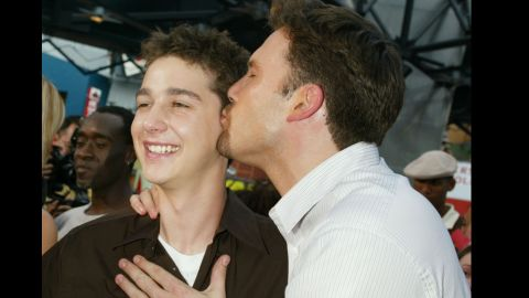 """Affleck kisses Shia LaBeouf at the premiere of """"The Battle of Shaker Heights,"""" a film he and Matt Damon executive produced in 2003."""